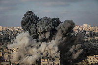 Smoke rises from a multi-storey building after it was bombed by an Israeli aircraft in Gaza City, Gaza Strip, 09 August 2018. According to the Israeli Army, Israel has launched a wave of airstrikes on the Gaza strip in response to more than 180 rockets and mortars being fired into Israel, and gunfire earlier Wednesday that targeted civilian construction workers on the Gaza border. Photo: Emad Awad/dpa /MediaPunch ***FOR USA ONLY***