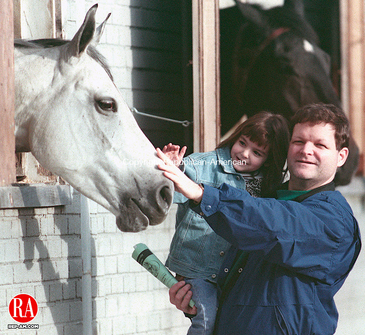 SOUTHBURY,CT-11/15/98-1115CK01.tif-Mark DiDsbury and his daughter Rachel age 4 pet one of the horses from the barn window after the Seraphim farm showcase of horses presentation on Sunday in Southbury.   CASEY KEIL PHOTO.