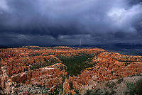730750022 a monsoon summer storm brings rain clouds and lightning to the hoodoos of bryce canyon national park in south central utah
