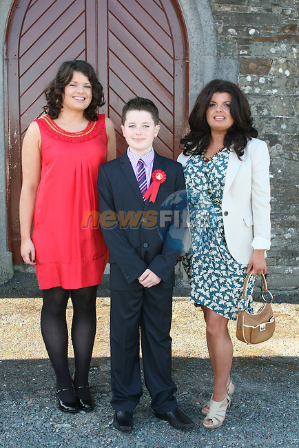 Jack Taggart with Emer and Jessica at his Confirmation in Clogherhead Church...Photo NEWSFILE/Jenny Matthews.(Photo credit should read Jenny Matthews/NEWSFILE)....This Picture has been sent you under the condtions enclosed by:.Newsfile Ltd..The Studio,.Millmount Abbey,.Drogheda,.Co Meath..Ireland..Tel: +353(0)41-9871240.Fax: +353(0)41-9871260.GSM: +353(0)86-2500958.email: pictures@newsfile.ie.www.newsfile.ie.FTP: 193.120.102.198.