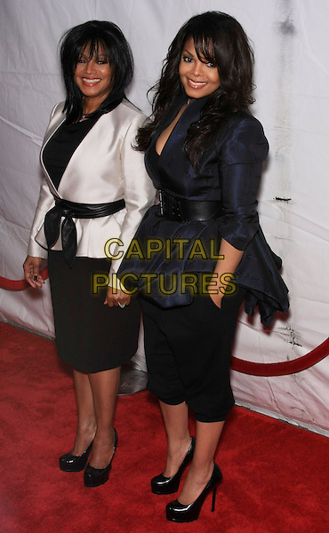 "REBBIE JACKSON & JANET JACKSON.attending the Special New York Screening of ""Why Did I Get Married Too?"" held at the School of Visual Arts Theater, New York, NY,.March 22nd, 2010..full length fringe navy blue jacket waist belt black cropped trousers hands in pockets shoes heels platform smiling  family sisters sister siblings family same shoes skirt white cream silk satin                                                              CAP/LNC/TOM.©LNC/Capital Pictures."