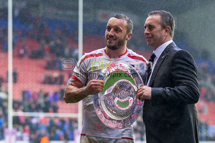 Picture by Alex Whitehead/SWpix.com - 14/11/2015 - Rugby League - England v New Zealand, Third Test - DW Stadium, Wigan, England - England's Josh Hodgson and head coach Steve McNamara celebrate with the trophy.
