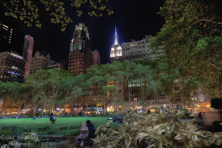 A night time view of NYC from Bryant Park looking south towards the Empire State Building.