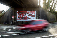 Thursday 02 March 2017<br /> Pictured: Cars pass an advert for a Ford car in the town of Bridgend <br /> Re: Ford expects to cut more than 1,100 jobs from its Bridgend plant by 2021, casting doubt on the future of the Welsh engine facility.