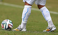 The Adidas football boots of Luis Suarez of Uruguay as he prepares to kick the Adidas Brazuca match ball