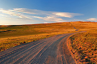 Gravel road at sunset. Steens Mountain. Oregon