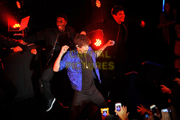 Austin Mahone performing his debut show in the UK, Cafe de Paris, London, England. <br /> 17th July 2013<br /> on stage in concert live gig performance performing music half length blue jacket fans crowd audience recording mobile phones hands arms dancing<br /> CAP/MAR<br /> &copy; Martin Harris/Capital Pictures