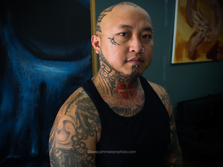 Kani Xiong is a tattoo artist in Appleton, Wisconsin