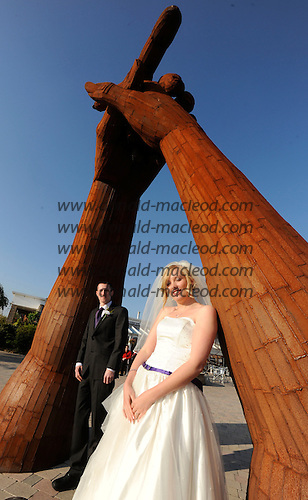 Gail (nee McPhillips) and James Pilcher, from Newton Stewart, who married at 3pm, at the archway at the Old Blacksmiths Shop at Gretna Green - 10.10.10 - picture by Donald MacLeod - mobile 07702 319 738 - clanmacleod@btinternet.com - www.donald-macleod.com