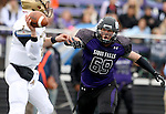 SIOUX FALLS, SD - OCTOBER 18: Evan Gentry #69 from the University of Sioux Falls applies pressure to Charlie Kern #7 from Southwest Minnesota State in the first half of their game Saturday afternoon at Bob Young Field in Sioux Falls. (Photo by Dave Eggen/Inertia)