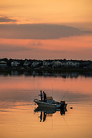 Saltwater fishing from boat in bay, Stone Harbor, New Jersey, USA