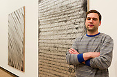 """Pictured: RA student Ziggy Grudzinskas (b. 1982, Australia) with his artworks. The Royal Academy Schools annual exhibition """"Premiums Interim Projects"""" features the work of 17 postgraduate students in their second year of study at the prestigious RA Schools. The artists present a broad range of work, from drawing and painting to sculptural installation and performance work. The following artists are exhibiting in the show: Caroline Abbotts, Rebecca Ackroyd, Victoria Adam, Matthew Ager, Sofie Alsbo, Hannah Bays, Josie Cockram, Henry Coleman, Adam Collier, Ziggy Grudzinskas, Maria de Lima, Declan Jenkins, Evelyn O'Connor, Laurence Owen, Max Prus, Sean Steadman and Joel Whyllie. The exhibition is open from 7 to 19 March 2014, Burlington Gardens, RA, London."""