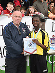 Drogheda Town's Bema Beite is presented with man of the match award by Turlough Maher after his team beat Walshestown in the DDSL under 13 cup final in United Park. Photo:Colin Bell/pressphotos.ie