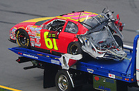 Apr 26, 2008; Talladega, AL, USA; The crashed car of NASCAR Nationwide Series driver Kevin Lepage is towed to the garage during the Aarons 312 at the Talladega Superspeedway. Mandatory Credit: Mark J. Rebilas-