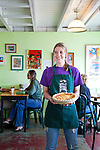 Two Loons Cafe, a sandwich shop located in Old Town Bandon, Oregon. Employee Ashley holding an artichoke and pepper quiche.