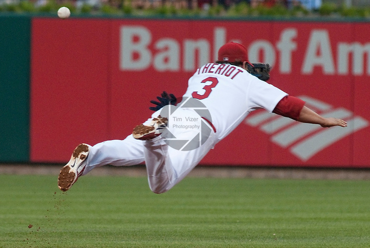 01 June 2011                 St. Louis Cardinals shortstop Ryan Theriot (3) dives through the air trying to snag a hit up the middle. The San Francisco Giants defeated the St. Louis Cardinals 7-5 in 11 innings  on Wednesday June 1, 2011 in the third game of a four-game series at Busch Stadium in downtown St. Louis.