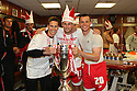 David Bridges (l),  Joel Byrom and Chris Beardsley of Stevenage celebrate in the dressing room after winning the npower League 2 play-off final between Stevenage and Torquay United at Old Trafford, Manchester on 28th May, 2011.© Kevin Coleman 2011.