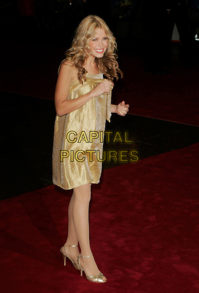 "MELINDA MESSENGER.Attending the UK Film premiere of ""The Golden Compass"" at the Odeon Leicester Square,.London, England, November 27th 2007..full length gold dress.CAP/AH.©Adam Houghton/Capital Pictures."