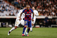 1st March 2020; Estadio Santiago Bernabeu, Madrid, Spain; La Liga Football, Real Madrid versus Club de Futbol Barcelona; Arturo Vidal (FC Barcelona) breaks away from Casemiro of Madrid