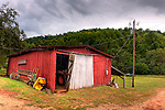 A shed by the driveway and parking area houses farm equipment, at Mountain Cove Vineyards.  (HDR image.)