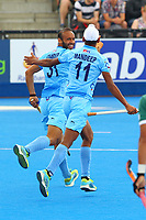India's Mandeep Singh joins goalscorer Ramandeep Singh in scoring his teams fourth goal during the Hockey World League Semi-Final 5-8th place match between Pakistan and India at the Olympic Park, London, England on 24 June 2017. Photo by Steve McCarthy.