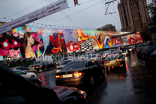 Moscow, Russia<br /> September 17, 2009<br /> <br /> Moscow's evening rush-hour traffic on ulitsa Zatsepskiy Val near the Paveletskaya metro station, ringed by a block long advertisement which is common in Moscow to cover up major sites of new construction.
