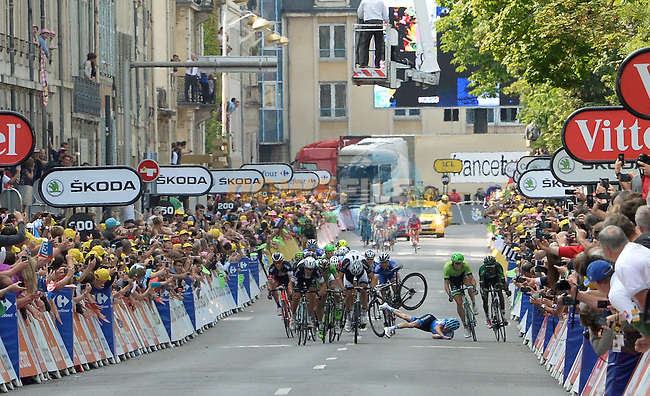 Andrew Talansky (USA) Garmin-Sharp crashes with 300m to go as Matteo Trentin (ITA) Omega Pharma-Quick Step wins the stage at the finish line of Stage 7 of the 2014 Tour de France running 234.5km from Epernay to Nancy. 11th July 2014.<br /> Photo ASO/G.Demouveaux/www.newsfile.ie