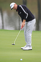 Michael Hoey (NIR) putts on the 9th green during Saturay's Round 3 of the 2014 BMW Masters held at Lake Malaren, Shanghai, China. 1st November 2014.<br /> Picture: Eoin Clarke www.golffile.ie