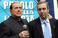 Il leader del Popolo della Liberta' Silvio Berlusconi abbraccia il deputato Maurizio Gasparri, destra, durante la presentazione del Camper della Liberta' in Piazza del Popolo, Roma, 12 marzo 2008..Leader of the People of Freedom's center-right coalition Silvio Berlusconi embraces lawmaker Maurizio Gasparri, right, as he speaks to present the Camper of Freedom in Rome's Piazza del Popolo, 12 march 2008..UPDATE IMAGES PRESS/Riccardo De Luca