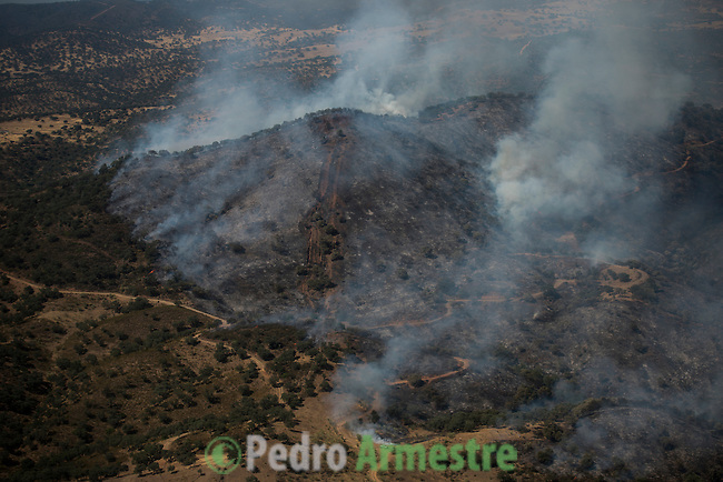 Aerial image a forest fire in El ronquillo, near Sevilla on July 26, 2015. Firefighters of Brica&acute;s Malaga 703 of the service of andalucian Infoca plan work in the wildfire in El Ronquillo, near Sevilla on July 26, 2015.<br /> Since July 19 wildfires have ravaged nearly 39,000 hectares of land in Spain, according to the provisional figures from the agriculture ministry. &copy; Pedro ARMESTRE