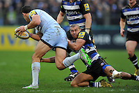 Jonathan Joseph of Bath Rugby puts in a tackle. Aviva Premiership match, between Bath Rugby and Worcester Warriors on December 27, 2015 at the Recreation Ground in Bath, England. Photo by: Patrick Khachfe / Onside Images