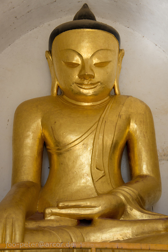 golden Buddha statue inside Thatbyinnyu Phaya temple, Bagan archeological site, Myanmar, 2011
