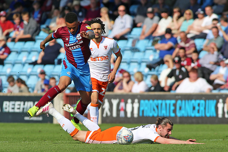 Blackpool's Ben Heneghan is fouled by Scunthorpe United's Funso Ojo<br /> <br /> Photographer David Shipman/CameraSport<br /> <br /> The EFL Sky Bet League One - Scunthorpe United v Blackpool - Friday 19th April 2019 - Glanford Park - Scunthorpe<br /> <br /> World Copyright © 2019 CameraSport. All rights reserved. 43 Linden Ave. Countesthorpe. Leicester. England. LE8 5PG - Tel: +44 (0) 116 277 4147 - admin@camerasport.com - www.camerasport.com