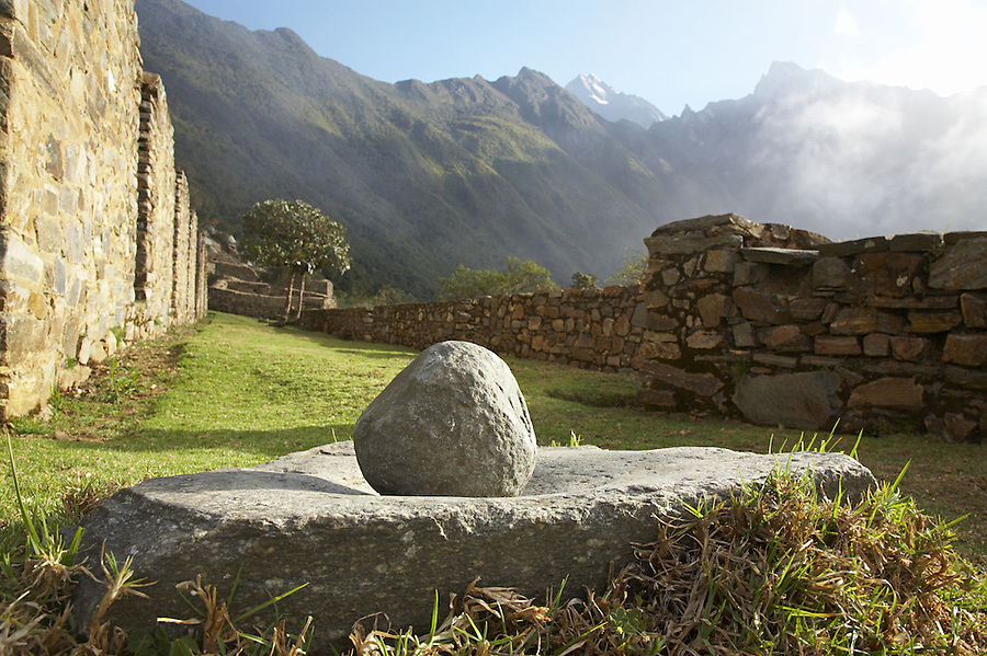 Primitive mortar for grinding corn at the remote Incan ruins of Choquequirao in the Peruvian Andes.
