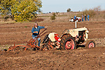 Antique tractors plowing a field in fall during the Branch 158 EDGE & TA Fall Plow Day and Plowing Seminar near Pleasant Grove, Calif...Silmer Scheidel Farm..early 1950s Case Mod. VAO tractor