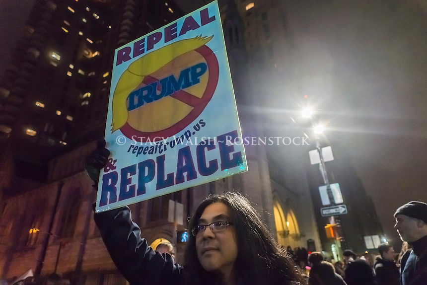 New York, USA 19 Jan 2017 - On the eve of the presidential inauguration thousands of New Yorkers rallied on Central Park West to protest against the inauguration of Donald Trump. The rally, called for by Michael Moore, Alec Baldwin, Al Sharpton, Rosy Perez and New York City Mayor Bill de Blasio, stretched from Columbus Circle to West 67th Street. Those who were too far away watched a live broadcase on their smart phones. ©Stacy Walsh Rosenstock