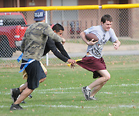 NWA Media/ J.T. Wampler -  A group of friends get together every Sunday morning to play flag football in Rogers before retreating to their houses to watch professional football on tv.