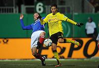FUSSBALL   DFB POKAL   SAISON 2011/2012   VIERTELFINALE Holstein Kiel - Borussia Dortmund                          07.02.2012 Moritz Leitner (re, Borussia Dortmund) gegen Marc Heider (li, Kiel)