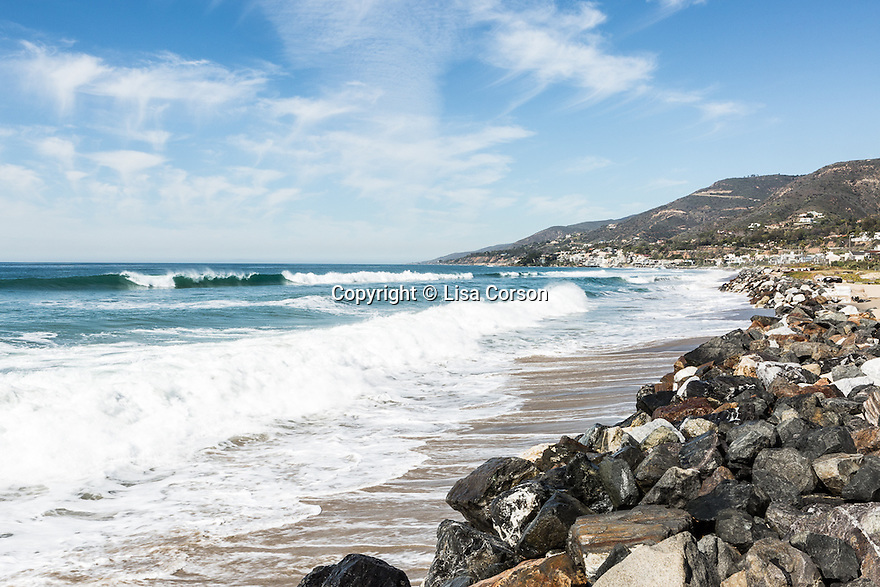 A rock retaining wall protects the beach behind the homes on Broad Beach Road from erosion. Malibu, California.