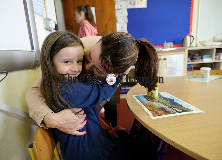Jennifer Rooney kisses her daughter Lydia, a senior infant, goodbye on her first day back in school at Boston NS. Photograph by John Kelly.