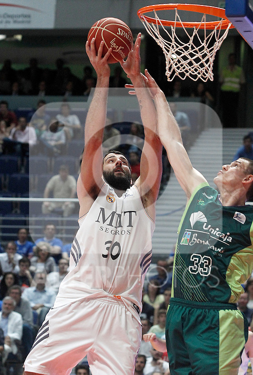 Real Madrid's Ioannis Bourousis (l) and Unicaja's Nik Caner-Medley during Liga Endesa ACB Semifinal match.June 6,2014. (ALTERPHOTOS/Acero)