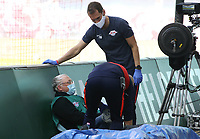 16th May 2020, Red Bull Arena, Leipzig, Germany; Bundesliga football, Leipzig versus FC Freiburg; An employee is hit by a ball off the pitch and has to be treated by the teams medical staff