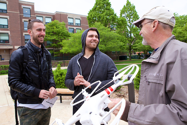 Using an unmanned aerial vehicle (UAV), also known as a drone, Associate Professor of Geography, Patrick McHaffie introduces students in his Remote Sensing course to the latest technology in aerial photography and imaging Tuesday, May 19, 2015 on the Lincoln Park Quad. Remote Sensing is a central part of geospatial data analysis and GIS mapping. McHaffie is incorporating drone imaging into his Remote Sensing I and Remote Sensing II courses to give students the opportunity to learn about and participate in the emerging segment of the remote sensing industry. (DePaul University/Jeff Carrion)