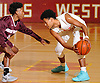 Derek Brower #2 of Half Hollow Hills West, right, gets pressured by D'Andre Edwards #13 of Deer Park during a Suffolk County League IV varsity boys basketball game at Half Hollow Hills West High School on Thursday, Dec. 21, 2017. Deer Park won by a score of 62-38.