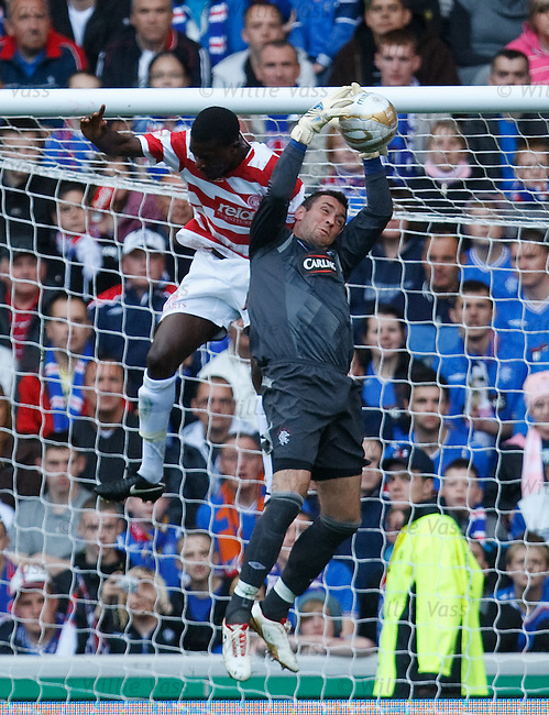 Allan McGregor saves from David Louhoungou