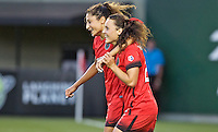 Portland, Oregon - Saturday July 2, 2016: Portland Thorns FC forward Nadia Nadim (9) and Hayley Raso (21) celebrate after making a penalty kick during a regular season National Women's Soccer League (NWSL) match at Providence Park.