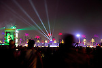 Lights and lasers light up the night sky as festival-goers make their way to another concert at the Coachella Valley Music and Arts Festival in Indio, California April 10, 2015. (Photo by Kendrick Brinson)