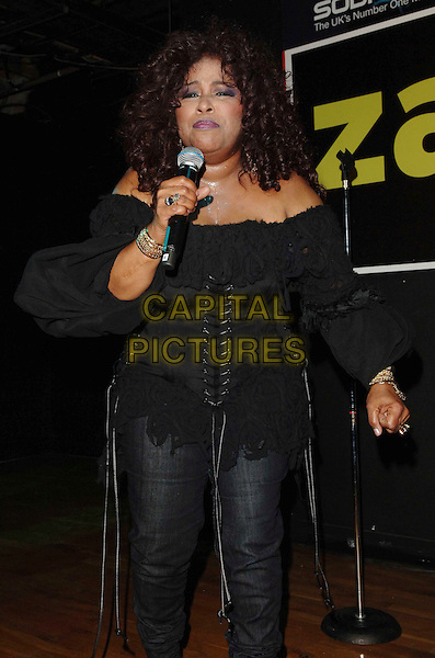 CHAKA KHAN .In store appearance at Zavi, Oxford Street, London, England, July 7th 2008..half length jeans performing live concert gig black top lace up corset music .CAP/WIZ.©Wizard/Capital Pictures