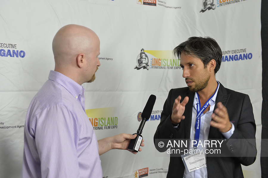 Bellmore, New York, United States. July 10, 2015. MICHAEL NAKACHE, the Director of the short film TRANSFERENCE, is interviewed at the Official Opening Night Reception and Technical Awards presentation of LIIFE, Long Island International Film Expo, in the Filmmakers Lounge. Transference is about a young psychoanalyst whose new patient is more than she bargained for. LIIFE events, including screenings nextdoor at Bellmore Movies, panels, and ceremonies, span from July 8 through July 16.
