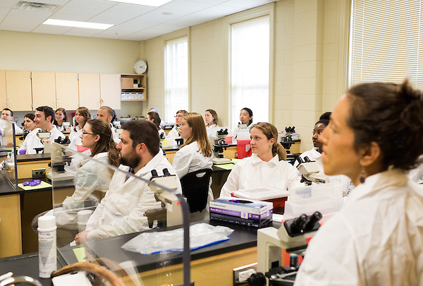May 7, 2014. Durham, North Carolina.<br />  First year students listen intently as their professor describes the lab assignment they are to conduct.<br />  The Duke University School of Medicine Physician Assistant Program is one of the top programs in the country for the training of physician's assistants. PA's are in high demand, and are taking over many of the tasks traditionally done by MD's, so the competition for the program is intense. In the most recent class, there were only 88 spots for a application pool of 1600.